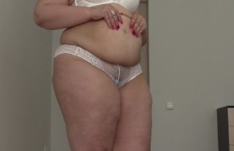 BBW crumples the stuffed stomach, shakes with fat. Fetish with a big belly.