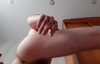 Russian guy after a shower jerks off his big cock in the room